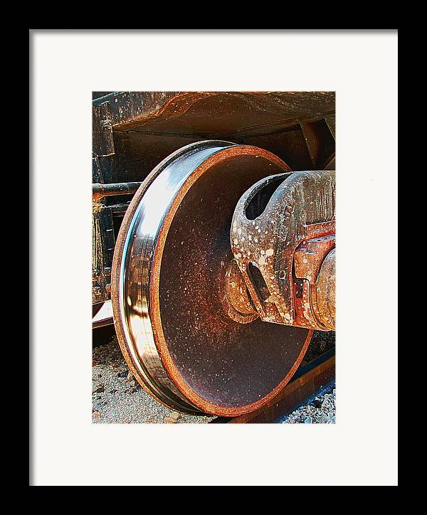 Train Framed Print featuring the photograph What Lies Beneath by Wendy J St Christopher