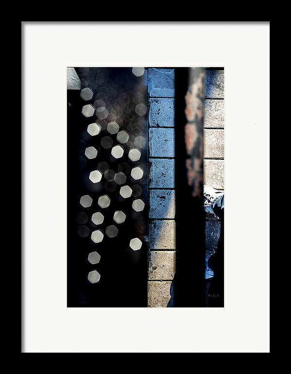 Abstract Framed Print featuring the photograph White Sneakers On The Edge by Bob Orsillo