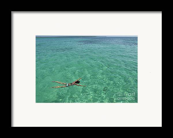 People Framed Print featuring the photograph Woman Snorkeling By Turquoise Sea by Sami Sarkis