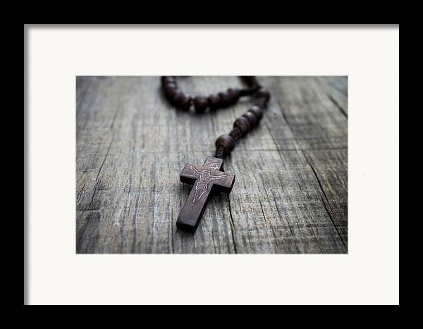 Cross Framed Print featuring the photograph Wooden Rosary by Aged Pixel
