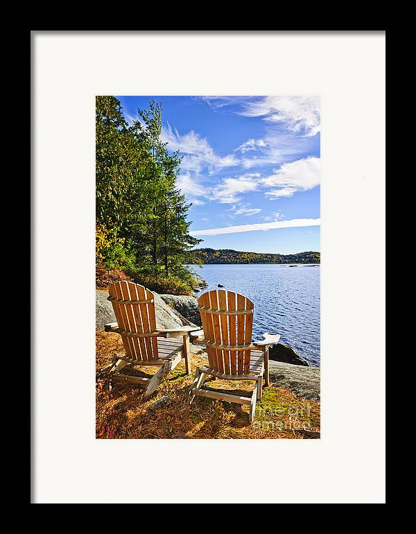 Chairs Framed Print featuring the photograph Adirondack Chairs At Lake Shore by Elena Elisseeva