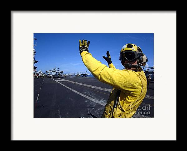Horizontal Framed Print featuring the photograph An Aviation Boatswains Mate Directs by Stocktrek Images