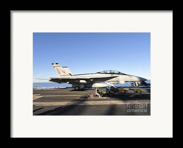 Us Navy Framed Print featuring the photograph An Fa-18f Super Hornet Launches by Stocktrek Images