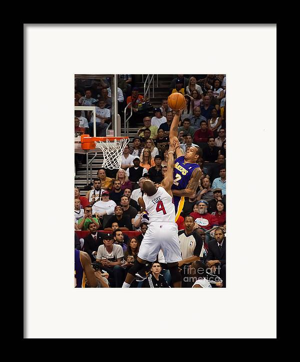 Slam Dunk Framed Print featuring the photograph Slam Dunk by Eddie Yerkish