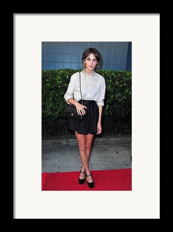 Alexa Chung Framed Print featuring the photograph Alexa Chung Wearing A 3.1 Phillip Lim by Everett
