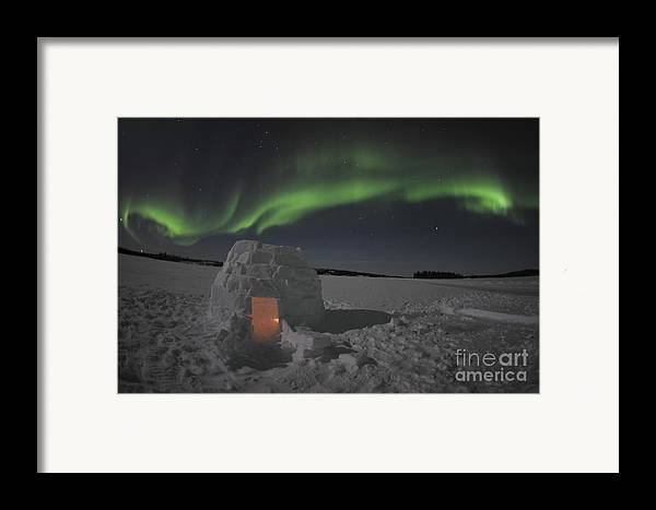 Yellowknife Framed Print featuring the photograph Aurora Borealis Over An Igloo On Walsh by Jiri Hermann