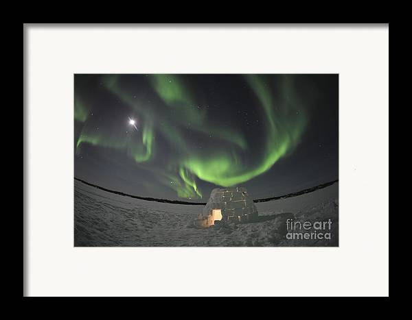 Yellowknife Framed Print featuring the photograph Aurora Borealis Over An Igloo On Walsh by Jiri Hermann