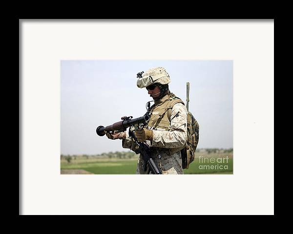 Camouflage Framed Print featuring the photograph A Marine Looks At A Brand New by Stocktrek Images