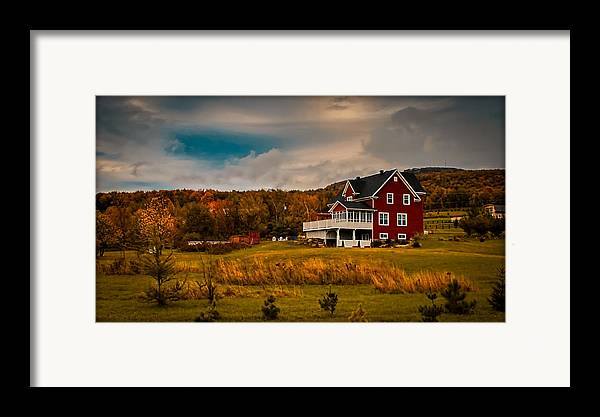 Red Farmhouse Framed Print featuring the photograph A Red Farmhouse In A Fallscape by Chantal PhotoPix