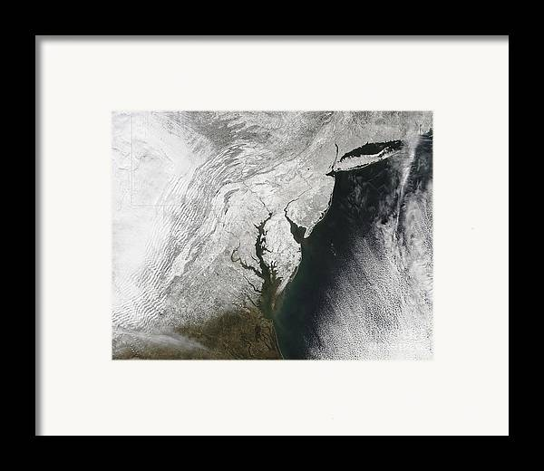 Blizzard Framed Print featuring the photograph A Severe Winter Storm Along The United by Stocktrek Images