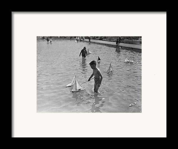 Child Framed Print featuring the photograph A Toy Boat by H F Davis