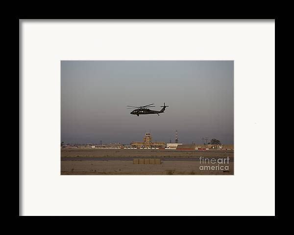 Aircraft Framed Print featuring the photograph A Uh-60 Blackhawk Helicopter Flies by Terry Moore