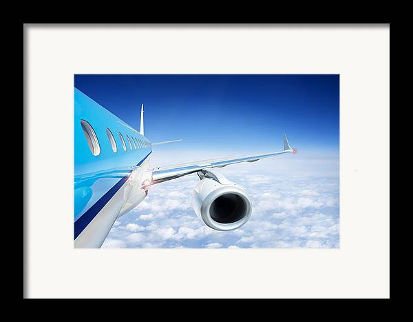 Flying Framed Print featuring the photograph Airliner In Flight Above The Clouds by Corepics
