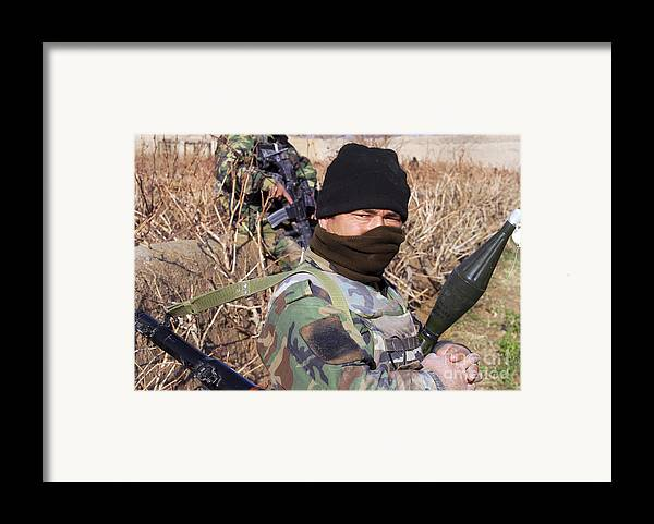 Special Forces Framed Print featuring the photograph An Afghan Commando On Patrol by Stocktrek Images
