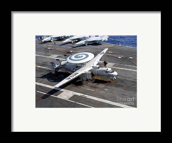 Flight Deck Framed Print featuring the photograph An E-2c Hawkeye Lands On The Flight by Stocktrek Images