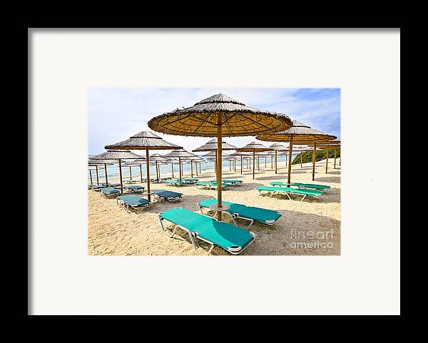 Beach Framed Print featuring the photograph Beach Umbrellas On Sandy Seashore by Elena Elisseeva