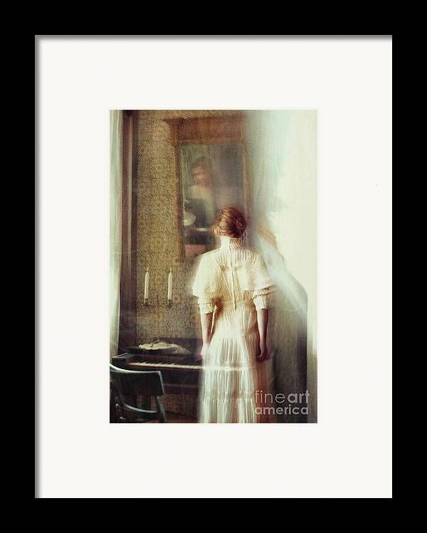 Atmosphere Framed Print featuring the photograph Blurry Image Of A Woman In Vintage Dress by Sandra Cunningham
