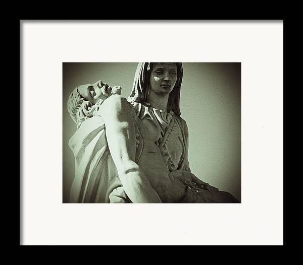 Madonna Framed Print featuring the sculpture Desend From The Cross by Felix Concepcion
