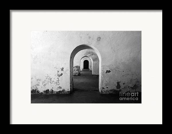 El Morro Framed Print featuring the photograph El Morro Fort Barracks Arched Doorways San Juan Puerto Rico Prints Black And White by Shawn O'Brien
