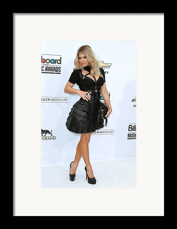 Fergie Framed Print featuring the photograph Fergie Wearing A Herve Leger By Max by Everett