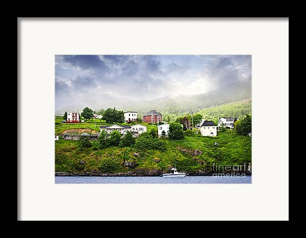 Fishing Framed Print featuring the photograph Fishing Village In Newfoundland by Elena Elisseeva