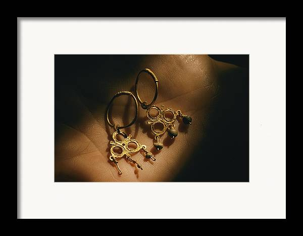 Atlantic Islands Framed Print featuring the photograph Gold Earrings Hung With Pearls Are Part by Ira Block