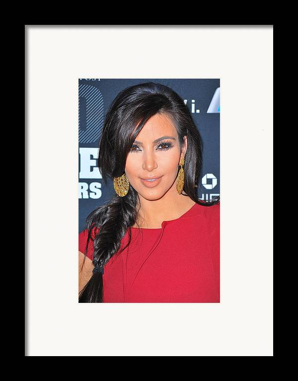 Kim Kardashian Framed Print featuring the photograph Kim Kardashian At Arrivals For 2011 by Everett