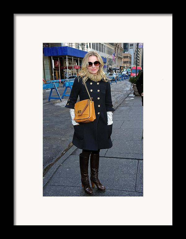 Kristen Bell Framed Print featuring the photograph Kristen Bell Out And About For Sun by Everett