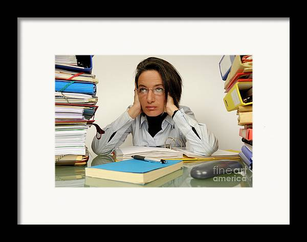 Casual Clothing Framed Print featuring the photograph Mature Office Worker Sitting At Desk With Piles Of Folders by Sami Sarkis
