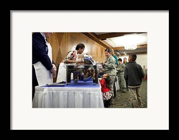 History Framed Print featuring the photograph Michelle Obama Talks With A Little Girl by Everett