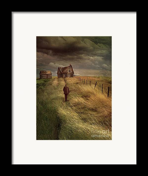 Alone Framed Print featuring the photograph Old Man Walking Up A Path Of Tall Grass With Abandoned House In by Sandra Cunningham