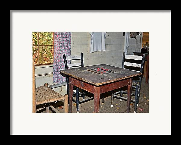 Checkers Framed Print featuring the photograph Playing Checkers by Susan Leggett
