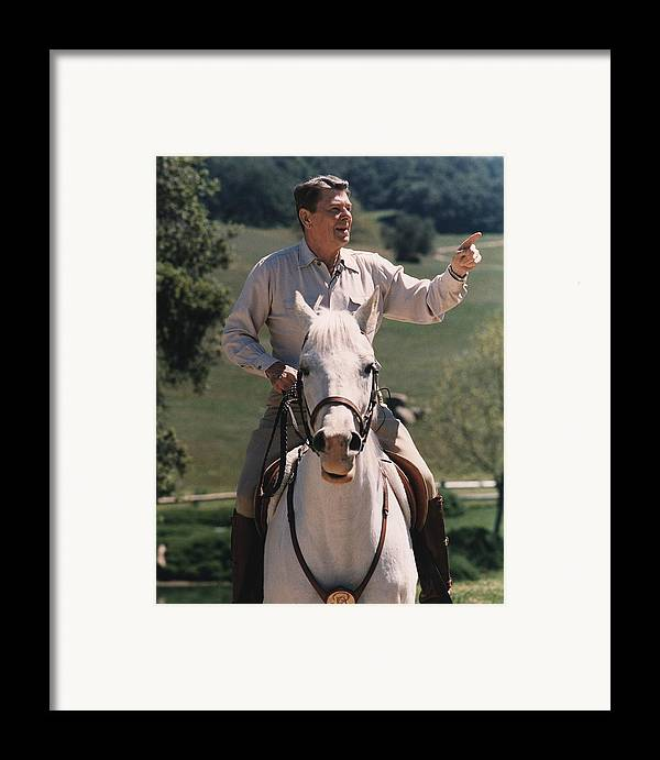 History Framed Print featuring the photograph President Reagan Riding His Horse El by Everett