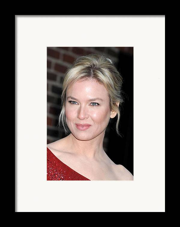 The Late Show With David Letterman Framed Print featuring the photograph Renee Zellweger At Talk Show Appearance by Everett