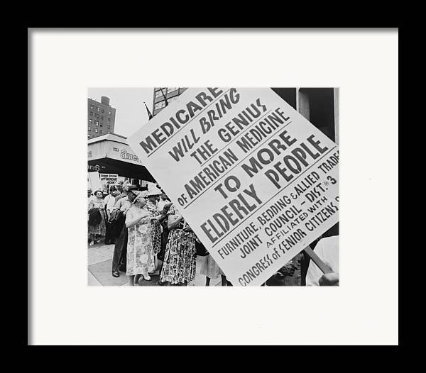 History Framed Print featuring the photograph Retired Senior Citizens Carrying by Everett