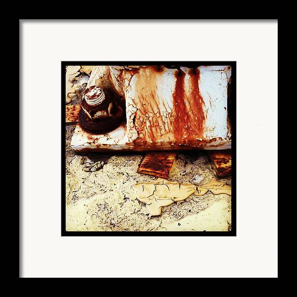 Rust Framed Print featuring the photograph Rusty Bolt Abstraction by Anna Villarreal Garbis