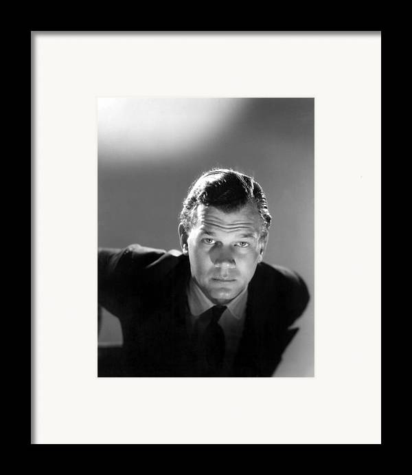 1940s Portraits Framed Print featuring the photograph Shadow Of A Doubt, Joseph Cotten, 1943 by Everett