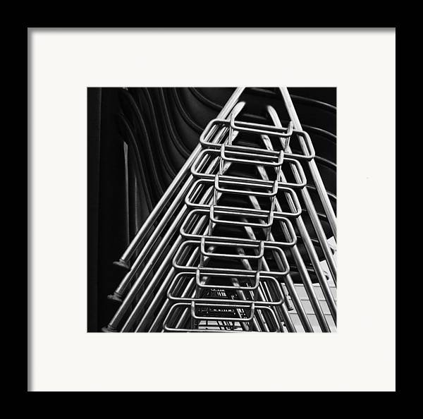 Abstract Framed Print featuring the photograph Stacks Of Chairs by Anna Villarreal Garbis