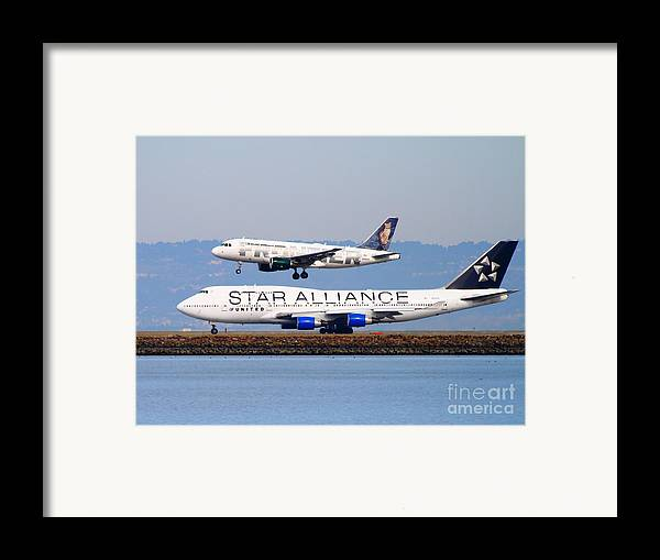 Airplane Framed Print featuring the photograph Star Alliance Airlines And Frontier Airlines Jet Airplanes At San Francisco International Airport by Wingsdomain Art and Photography
