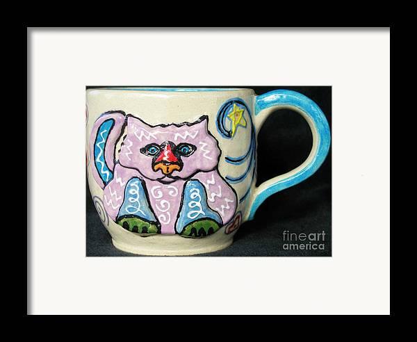 Cat Framed Print featuring the ceramic art Star Kitty Mug by Joyce Jackson