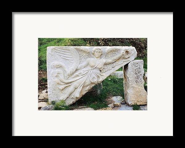 Stone Carving Framed Print featuring the photograph Stone Carving Of Nike by Mark Greenberg