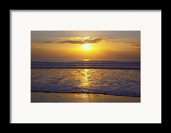 Beauty In Nature Framed Print featuring the photograph Sunset Over The Pacific Ocean Along The by Craig Tuttle