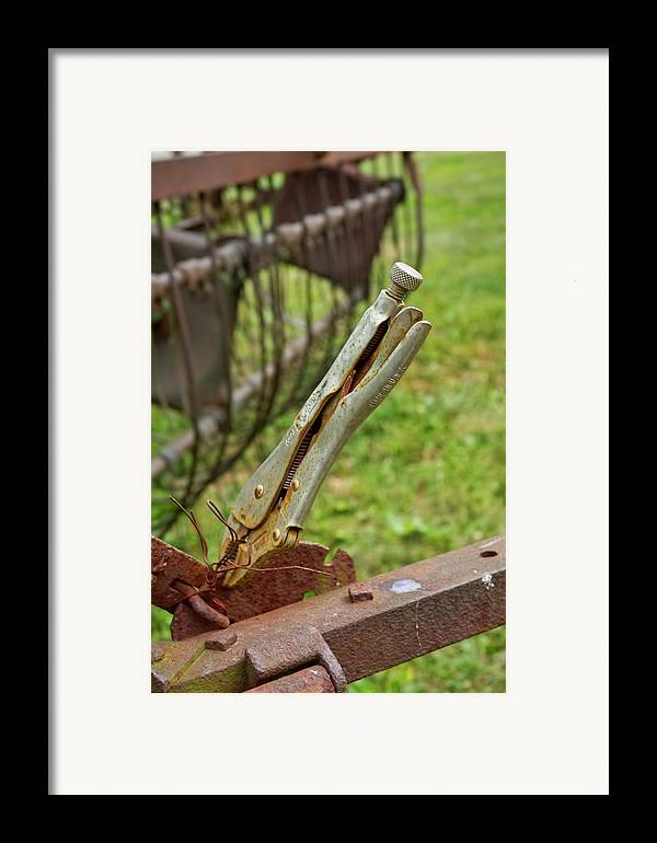 Tool Framed Print featuring the photograph There I Fixed It. by Michael Flood