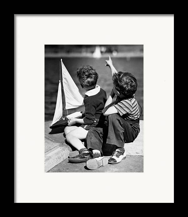 Child Framed Print featuring the photograph Two Boys Playing W/sailboats by George Marks
