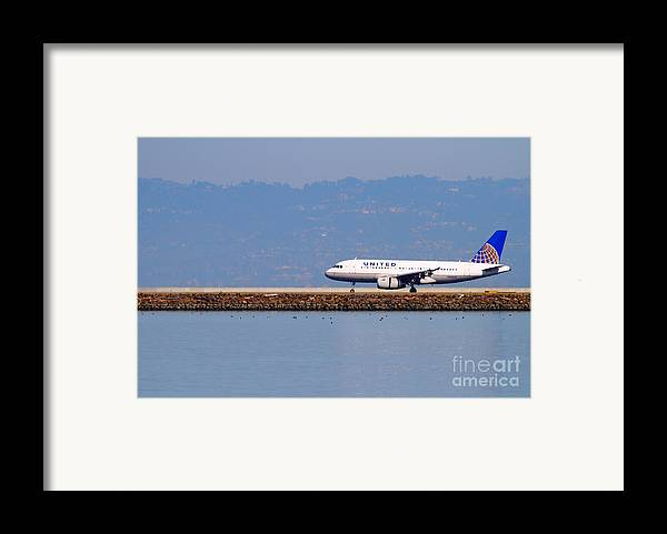 United Framed Print featuring the photograph United Airlines Jet Airplane At San Francisco International Airport Sfo . 7d11998 by Wingsdomain Art and Photography