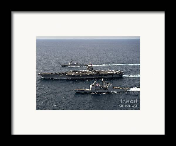 Atlantic Ocean Framed Print featuring the photograph U.s. Navy Ships Transit The Atlantic by Stocktrek Images