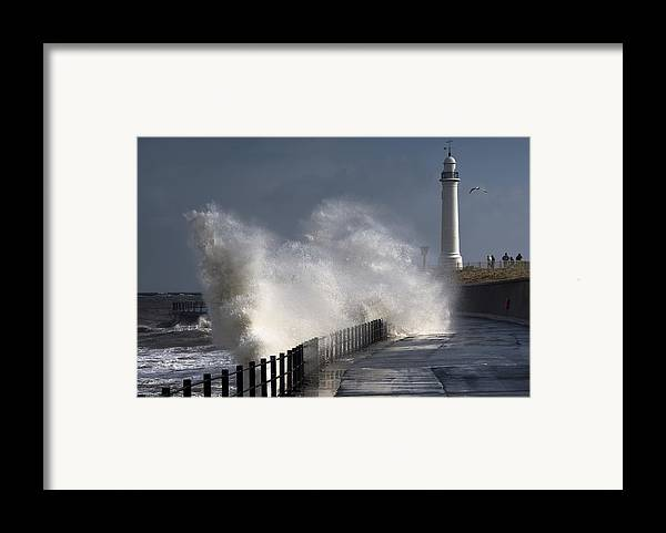Building Exterior Framed Print featuring the photograph Waves Crashing By Lighthouse At by John Short