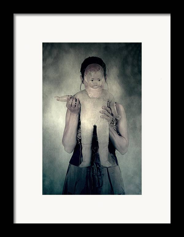Hide Framed Print featuring the photograph Woman With Doll by Joana Kruse