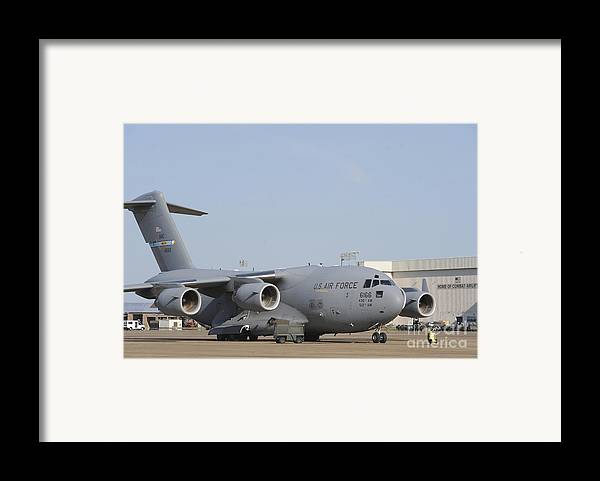 Military Framed Print featuring the photograph A C-17 Globemaster IIi Parked by Stocktrek Images