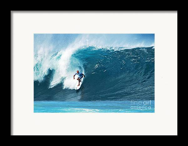Kelly Slater Framed Print featuring the photograph Pro Surfer Kelly Slater Surfing In The Pipeline Masters Contest by Paul Topp